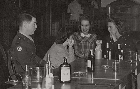 1st Lt. Gilbert J. O'Brien relaxing at Officers club